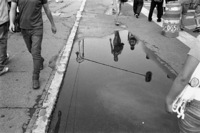 Callegrafia. Reflections in large puddle. Centro Historico, Mexico City.