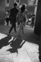 Callegrafia. Girl casting a strange shadow, downtown Mexico City